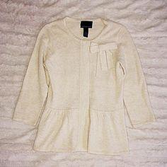 Cynthia Rowley Peplum Cardigan Sweater Size small. Poly / nylon / rabbit hair / wool. Beige. Hidden snap button closure. Peplum style. Very soft. Bow detail on front. Cynthia Rowley Sweaters Cardigans