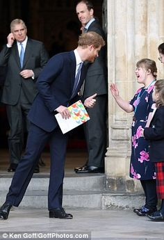 The posy bearer, who also handed flowers to the Queen and the Duchess of Cornwall, looked delighted to make Harry's acquaintance