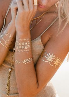 "Gold temporary tattoos! By Lulu DK. ""Love Story"" style. $22 for two sheets, one gold, one silver. Lasts 4-6 days. Celestials ideas"