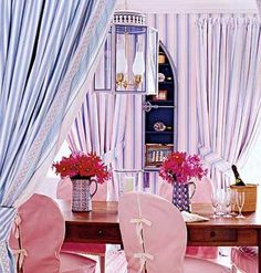 Match curtains to wallpaper to create a dramatic, cocoon-like dining or living room. For extra personality, fashion a second, complementary fabric on the reverse side of the panel.