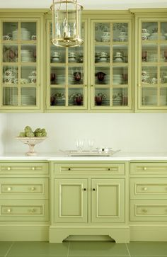 Paint the inside of your cupboards in a coordinating colour.