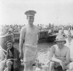 ANZAC soldiers by the sea on Anzac Beach, likely about to bathe, 1915.