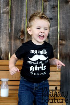 my milk mustache brings all the girls to the yard - t-shirt - fun baby shower gift - black and white tee. $25.00, via Etsy.