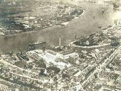 Aerial View, Deptford, Lewisham, 1925 Deptford at its most industrial, showing the newly completed Deptford West power station. Prominently visible is Deptford dry dock and Wood Wharf on the east side of Deptford Creek. Creek Road, with its more ancient neighbour 'The Stowage', ran from the centre bottom to the centre right of the picture.Many of the Victorian terraces to the left were shortly to be redeveloped by the London County Council as the Hughes Field Estate.The ancient parish…
