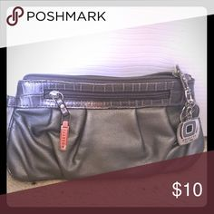 Clutch/wristlet Maybe used once. Has pockets/slots  for ID and multiple cards Bags Clutches & Wristlets