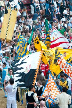 contrade flags flying on Palio day, Siena, Tuscany