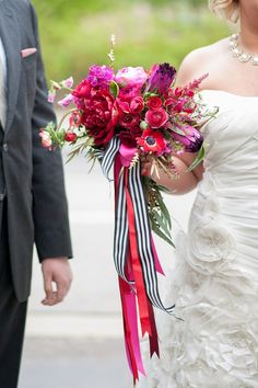 Amazing pink and red bouquet with anemones, peonies, sweet peas, ranunculus and more. Tied with a great black and white striped ribbon. #vibrant #colorfulbouquet #blackandwhite