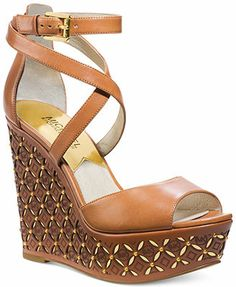 Love these...now if I can find this style minus the name brand and the $195 price - ridiculous for sandals.