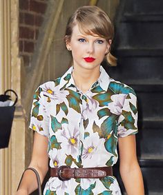 Taylor Swift squeezed in another workout and was snapped leaving the gym in a bold floral-print button-down Topshop romper, cinching it at the waist with a brown belt. Suede goldenrod yellow Gucci pumps and her go-to Dolce & Gabbana tote completed her look.