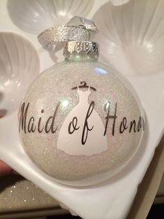 Cute way to ask your maid of honor to be in your wedding...especially a winter wedding.  Glass ornament, mop and glo and glitter. Cut dress and words with a cricut.