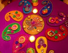 Hand made mehndi plates. Multi coloured combination with a gold centre plate. Have a look at my Facebook page www.facebook.com/mehnditraysforfun for more stunning designs