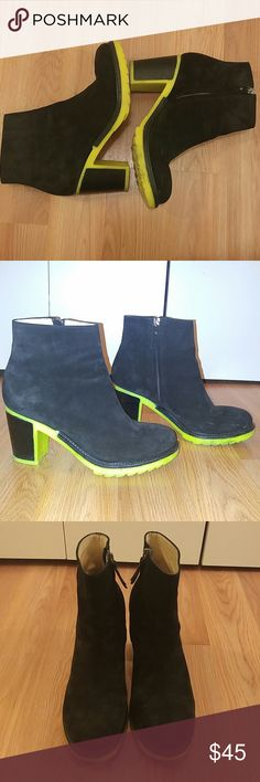B store black suade with yellow/green neon soles Birkenstock B store black suade ankle boots with neon yellow/green soles. 3 inch heal with 1/2 inch sole. I bought a 1/2 size too big for me, could not return. Only worn 4 times. Birkenstock Shoes Ankle Boots & Booties