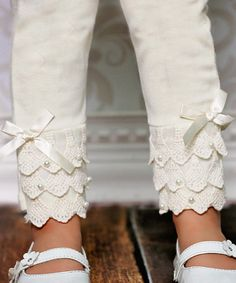 Look at this #zulilyfind! Ivory Lace Ruffle Leggings - Toddler & Girls by Designs by Meghna #zulilyfinds