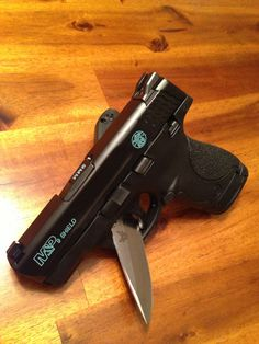Painted the engravings on my fiancée's M&P Shield. She asked for Tiffany Blue. Turned out awesome!