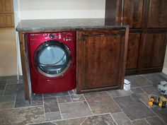 Love the idea of hiding away the washer/dryer in the kitchen! Now to just buy a front loading washer/dryer set....