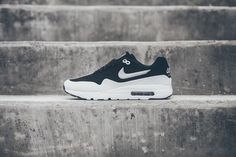 The Nike Air Max 1 Ultra Moire Black / White has a simple two tone look with a Black perforated top portion and crisp White bottom half.