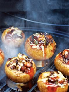 These smoked onions, stuffed with bacon and cheese, get smoky flavor from your favorite hardwood.