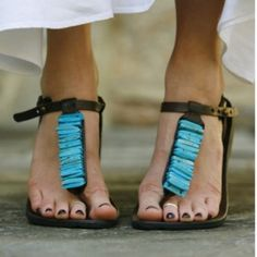 Leather and turquoise sandals Excellent pre-worn condition. Dark leather sandals with turquoise stones. Genuine. No trades. Shoes Sandals