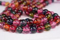 natural quartz crystals - wholesale bead suppliers - colorful clear quartz, rock crystal, 10mm,  round bead, tourmaline like be