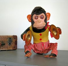 Vintage Mechanical Monkey Toy like the one Grace's grandmother found in the antique shop--An Uncommon Grace--Serena Miller