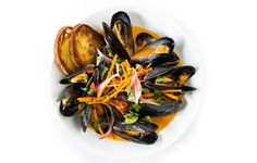 The recipe for Aqua at Kings Creek Marina's red curry mussels was featured in Bon Appetite.