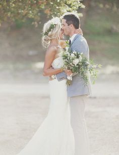 A kiss on the forehead from the groom