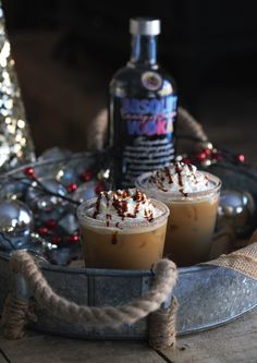 This Gingerbread White Russian is the perfect holiday cocktail full of rich coffee flavor mixed with a sweet molasses drizzle. #cocktail #christmas