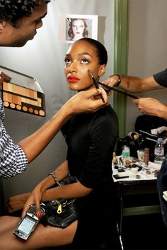Getting dolled up backstage- love her bold lip!