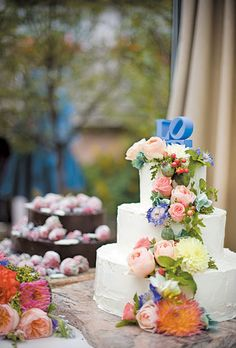 White Wedding Cake with Spring Flowers. The vanilla cake by Mountain Flour was topped with a miniature LOVE statue from Blue Butterfly Design.