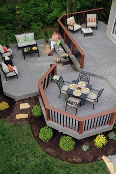 TimberTech Terrain decking collection in Silver Maple with Evolutions Rail Contemporary in Brick and Black.