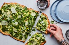 Find out how to make white pizza even better by topping with pesto-spiked ricotta and paper-thin, shaved seasonal veggies.