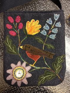 This is Michelle Pratt's bag by Bonnie Sullivan finished with all the stitching done on it. Pocket Full of Posies