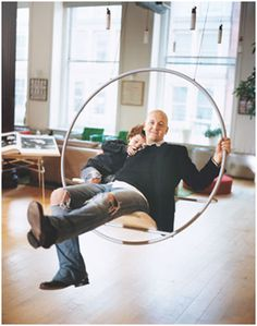 new york loft swing ... Okay, so I'm country ... this idea would be swell using a large distressed metal hoop, wagon wheel, tractor wheel, etc. An hour at the local welding shop and you have a dramatic conversation starter!
