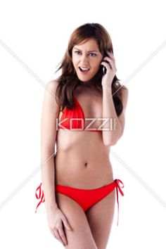 sexy young woman talking on mobile phone. - Image of a attractive young female talking on cell phone against white background. Model: Araina Nespiak