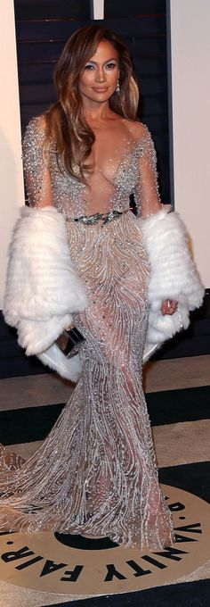 Jennifer Lopez in a sheer sparkling dress at the Vanity Fair Oscars afterparty