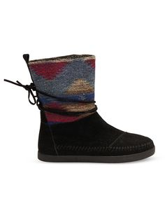 Stay comfortable in TOMS no matter the temperature. These Nepal boots have a suede upper with colorful wool detail and shearling lining.