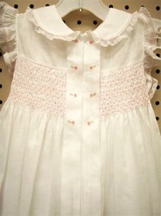 Super sweet tuck embellishment! This would be beautiful on baby girl.
