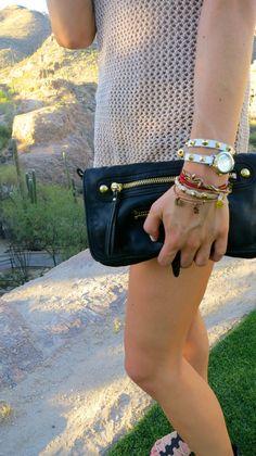 Linea Pelle black clutch + Alex and Ani bracelets + wrap watch