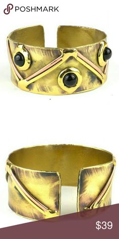 Handmade Brass and Copper Onyx Cuff Bracelet This bracelet is accented with onyx and polished brass and copper. The pattern on the brass is achieved by applying extreme heat and free from lead and nickel.  Since this brass and copper onyx cuff bracelet is handmade, there will be slight variations from the images you see on this listing.   Brand new, never used, didn't have tags Handmade Jewelry Bracelets