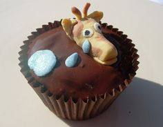 Giraffe swimming in mud cupcake. Of course.