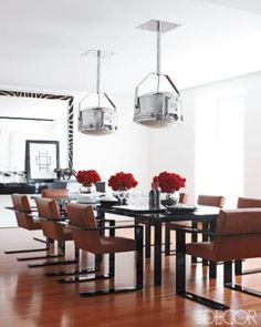 All-American Style    Ralph Lauren's Manhattan dining room epitomizes the fashion designer's restrained yet sophisticated aesthetic. Vintage light fixtures create a focal point above the sleek dining table and leather-upholstered chairs by Ralph Lauren Home, while a custom-made zebra-skin mirror by Richomme lends an exotic touch.