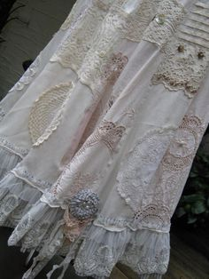 skirts from vintage linens, calico and the softest blends... embellished with the contents of 'grammy's hope chest' ...