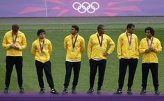 Brazil's players react while wearing their silver medals after losing to Mexico in their men's soccer final gold medal match at Wembley Stadium during the London 2012 Olympic Games August 11, 2012.