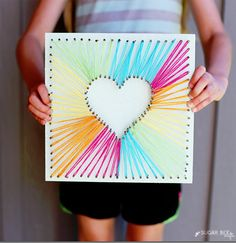 This home project is so simple. It's amazing what some string and a few nails can create! String art