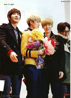 Chanyeol, Luhan and Chen supporting Sehun at his high school graduation.