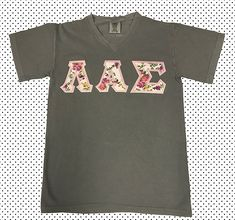 The combos are endless when you choose Floral White! You'll love the way we sew your Comfort Colors Letter Shirts. Greek Letter Shirts, Customize Your Own Shirt, Custom Greek Apparel, Letter Patterns, Greek Clothing, Comfort Colors, Neck Pattern, V Neck T Shirt, Sew