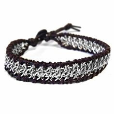 Saniki's newest design featuring GSGChainmaille Weavewith a dark brownleather cordwrap. Button Closure. A bit of Rock, A bit of Edge.Perfect casual bracelet.