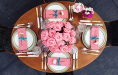 Romantic scenery dinner for four. Pink roses bouquet, vintage cutlery. Romantic tabletop. Vintage, Bavaria porcelain plates and cristal glasses. Outdoor dinner. Pink napkins DIY