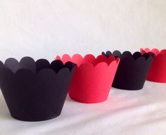 A personal favorite from my Etsy shop https://www.etsy.com/listing/189269652/12-count-black-and-red-scallop-cupcake