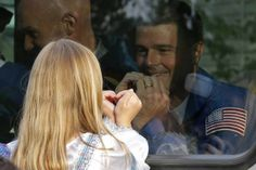 TIME Pictures of the week May 23- May 30 May 28, 2014. NASA astronaut Reid Wiseman, crew member of the mission to the International Space Station, ISS, gestures with his daughter, from a bus as they leave from a hotel prior the launch of Soyuz-FG rocket at the Russian leased Baikonur cosmodrome in Kazakhstan.